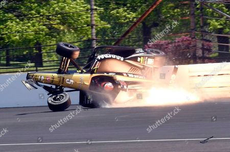 James Hinchcliffe, of Canada, slides into the backstretch after hitting the wall along the second turn during qualifications for the Indianapolis 500 IndyCar auto race at Indianapolis Motor Speedway, in Indianapolis