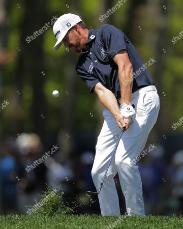 Jimmy Walker chips onto the ninth green during the third round of the PGA Championship golf tournament, at Bethpage Black in Farmingdale, N.Y