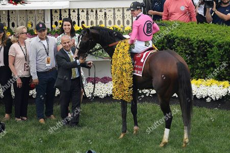 Stock Picture of Jockey Tyler Gaffalione sits aboard War of Will as Gary Barber holds the after winning the Preakness Stakes horse race at Pimlico Race Course, in Baltimore