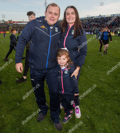 Cavan vs Monaghan. Cavan manager Mickey Graham celebrates after the game with his wife Linda and daughter Lauren (aged 5)