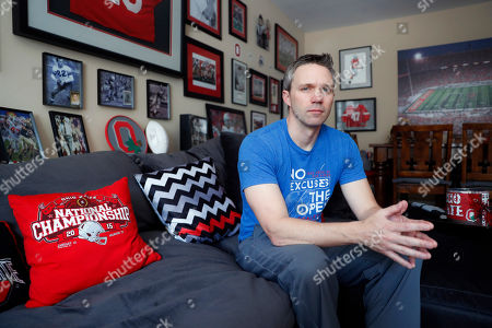 Brian Garrett poses for a photo at his home, in Powell. Ohio. Former nursing student Brian Garrett said he worked for a short time at an off-campus clinic Dr. Richard Strauss opened after he was ousted at Ohio State in the late 1990s. But Garrett quit after witnessing abuse by Strauss and then experiencing it himself