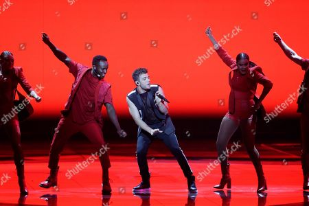 Contestant Luca Hanni (C) of Switzerland performs 'She Got Me' during the Grand Final of the 64th annual Eurovision Song Contest (ESC) at the Expo Tel Aviv, in Tel Aviv, Israel, 18 May 2019.