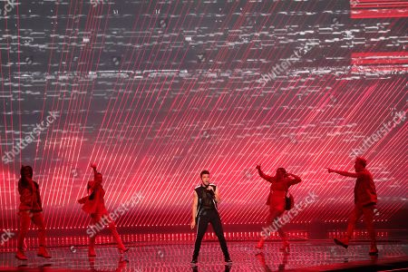 Stock Photo of Contestant Luca Hanni (C) of Switzerland performs 'She Got Me' during the Grand Final of the 64th annual Eurovision Song Contest (ESC) at the Expo Tel Aviv, in Tel Aviv, Israel, 18 May 2019.