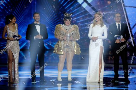 Israeli TV hosts Assi Azar (2-L), Lucy Ayoub (L) and Erez Tal (R) with supermodel Bar Refaeli (2-R) stand on stage with the winner of the 2018 Eurovision Song Contest Netta Barzilai (C) as they present the Grand Final of the 64th annual Eurovision Song Contest (ESC) at the Expo Tel Aviv, in Tel Aviv, Israel, 18 May 2019.