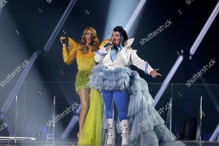 Stock Picture of Winner of the 2018 Eurovision Song Contest Netta Barzilai (R) and Winner of the 1998 Eurovision Song Contest Dana International (L) of Israel perform during the Grand Final of the 64th annual Eurovision Song Contest (ESC) at the Expo Tel Aviv, in Tel Aviv, Israel, 18 May 2019.