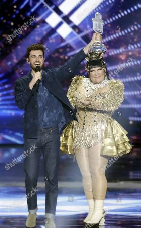 Eurovision Song Contest Duncan Laurence (C) of The Netherland receives the contest trophy from Netta Barzilai of Israel, last year's winner after the Grand Final of the 64th annual Eurovision Song Contest (ESC) at the Expo Tel Aviv in Tel Aviv, Israel, 18 May 2019.