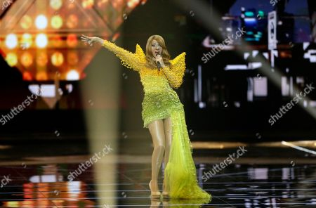 Stock Image of Winner of the 1998 Eurovision Song Contest Dana International of Israel perform during the Grand Final of the 64th annual Eurovision Song Contest (ESC) at the Expo Tel Aviv, in Tel Aviv, Israel, 18 May 2019.