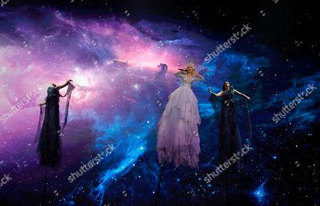 "Stock Image of Kate Miller-Heidke of Australia, center, performs the song ""Zero Gravity"" during the 2019 Eurovision Song Contest grand final in Tel Aviv, Israel"