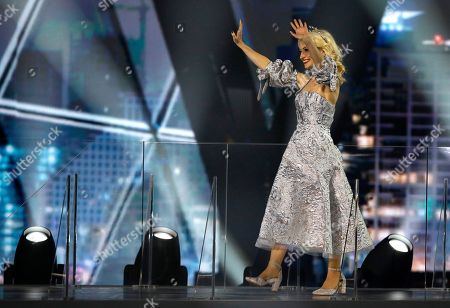 Kate Miller-Heidke of Australia waves as she walks onto the stage during the 2019 Eurovision Song Contest grand final in Tel Aviv, Israel
