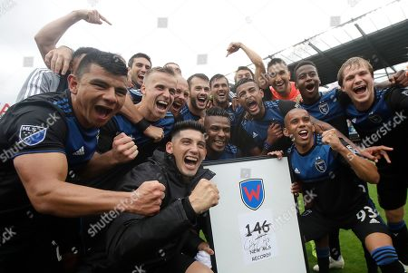 San Jose Earthquakes forward Chris Wondolowski, center rear, celebrates with teammates after they defeated the Chicago Fire in an MLS soccer match in San Jose, Calif., . Wondolowski scored four times to pass Landon Donovan for most career MLS goals
