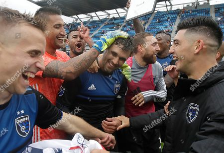 San Jose Earthquakes forward Chris Wondolowski, center, celebrates with teammates after they defeated the Chicago Fire in an MLS soccer match in San Jose, Calif., . Wondolowski scored four times to pass Landon Donovan for most career MLS goals