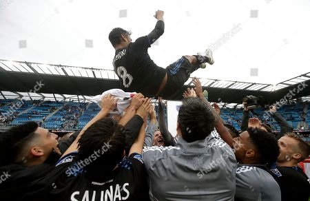 San Jose Earthquakes forward Chris Wondolowski, top, is hoisted by teammates after they defeated the Chicago Fire in an MLS soccer match in San Jose, Calif., . Wondolowski scored four times to pass Landon Donovan for most career MLS goals