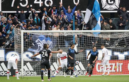 San Jose Earthquakes forward Chris Wondolowski, center, celebrates after scoring a goal against the Chicago Fire during the second half of an MLS soccer match in San Jose, Calif., . Wondolowski scored four times to pass Landon Donovan for most career MLS goals
