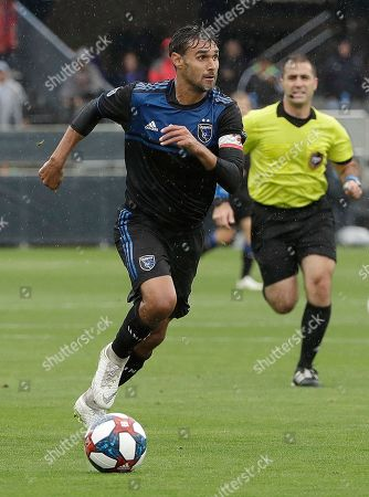 Stock Image of San Jose Earthquakes forward Chris Wondolowski dribbles the ball upfield against the Chicago Fire during the first half of an MLS soccer match in San Jose, Calif., . Wondolowski scored four times to pass Landon Donovan for most career MLS goals