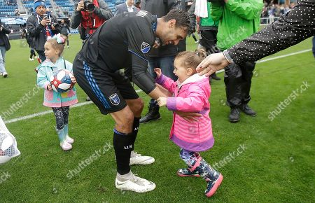 San Jose Earthquakes forward Chris Wondolowski, center, celebrates with his daughters after the Earthquakes defeated the Chicago Fire in an MLS soccer match in San Jose, Calif., . Wondolowski scored four times to pass Landon Donovan for most career MLS goals