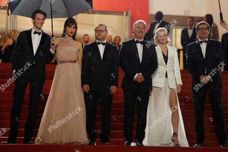 Sabin Tambrea, Catrinel Marlon, Corneliu Porumboiu, actors Vlad Ivanov, Rodica Lazar, Agusti Villaronga,Thierry Fremaux, Francisco Corea, Antonio Buil. Actors Sabin Tambrea, from left, Catrinel Marlon, director Corneliu Porumboiu, actors Vlad Ivanov, Rodica Lazar andAgusti Villaronga pose for photographers upon arrival at the premiere of the film 'The Whistlers' at the 72nd international film festival, Cannes, southern France