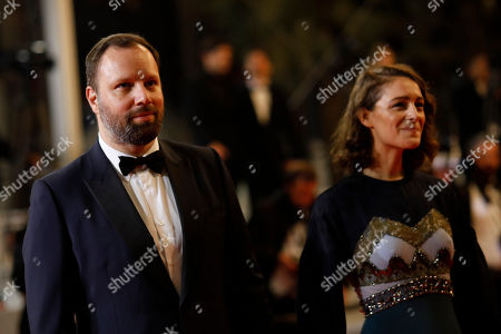 Yorgos Lanthimos, Ariane Labed. Jury member Yorgos Lanthimos, left, and actress Ariane Labed pose for photographers upon arrival at the premiere of the film 'The Whistlers' at the 72nd international film festival, Cannes, southern France
