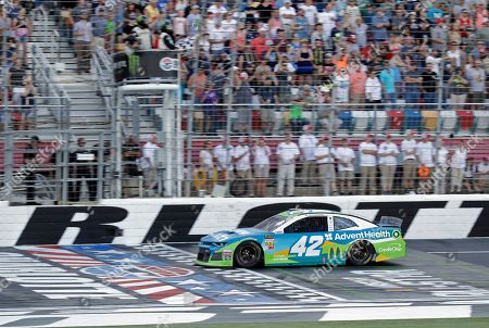 Kyle Larson takes the checkered flag to win the final segment of the NASCAR All-Star Open auto race at Charlotte Motor Speedway in Concord, N.C., . Larsen moved on to the All-Star Race with the win