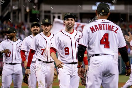 Howie Kendrick, Anthony Rendon, Trea Turner, Brian Dozier, Dave Martinez. From left, Washington Nationals second baseman Howie Kendrick (47), third baseman Anthony Rendon (6), shortstop Trea Turner, second baseman Brian Dozier (9) and manager Dave Martinez (4) celebrate after the Nationals defeated the Chicago Cubs 5-2 in a baseball game, in Washington