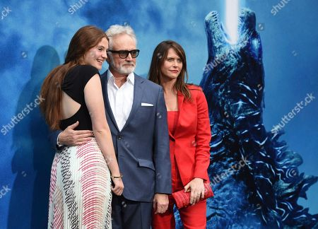 "Stock Image of Mary Louisa Whitford, Bradley Whitford, Amy Landecker. Mary Louisa Whitford, from left, Bradley Whitford and Amy Landecker arrive at the Los Angeles premiere of ""Godzilla: King of The Monsters"", at the TCL Chinese Theatre"