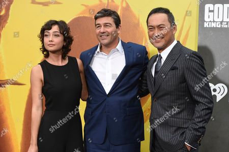 """Sydney Chandler, Kyle Chandler, Ken Watanabe. Sydney Chandler, from left, Kyle Chandler and Ken Watanabe arrive at the Los Angeles premiere of """"Godzilla: King of The Monsters"""", at the TCL Chinese Theatre"""
