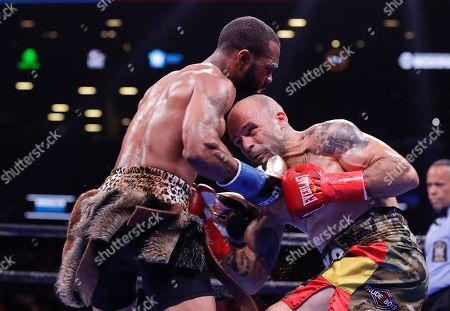 Gary Russell Jr., left, punches Spain's Kiko Martinez during the second round of the WBC featherweight championship boxing match, in New York. Russell stopped Martinez in the fifth round