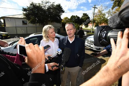 Federal leader of the Opposition Bill Shorten (R) speaks to media aside wife Chloe outside their property in Moonee Ponds, Melbourne, Victoria, Australia, 19 May 2019. Shorten has addressed the media outside his home following his defeat in the 2019 Federal Election last night. Media reports state that he would resign as the party leader.