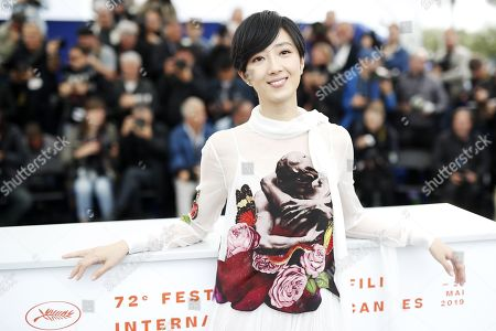 Gwei Lun Mei poses during the photocall for 'Nan Fang Che Zhan De Ju Hui' (The Wild Goose Lake) at the 72nd annual Cannes Film Festival, in Cannes, France, 19 May 2019. The movie is presented in the Official Competition of the festival which runs from 14 to 25 May.