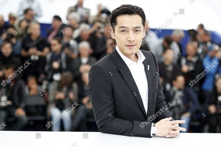 Hu Ge poses during the photocall for 'Nan Fang Che Zhan De Ju Hui' (The Wild Goose Lake) at the 72nd annual Cannes Film Festival, in Cannes, France, 19 May 2019. The movie is presented in the Official Competition of the festival which runs from 14 to 25 May.