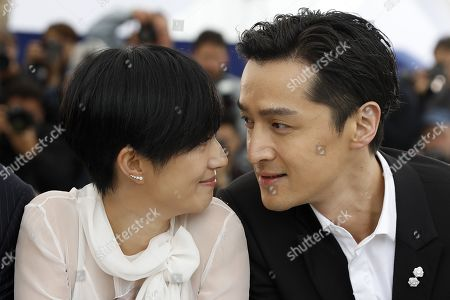 Gwei Lun Mei and Chinese actor Hu Ge pose during the photocall for 'Nan Fang Che Zhan De Ju Hui' (The Wild Goose Lake) at the 72nd annual Cannes Film Festival, in Cannes, France, 19 May 2019. The movie is presented in the Official Competition of the festival which runs from 14 to 25 May.
