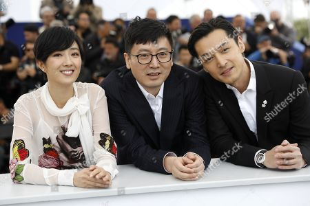 Gwei Lun Mei, Chinese director Diao Yinan and Chinese actor Hu Ge pose during the photocall for 'Nan Fang Che Zhan De Ju Hui' (The Wild Goose Lake) at the 72nd annual Cannes Film Festival, in Cannes, France, 19 May 2019. The movie is presented in the Official Competition of the festival which runs from 14 to 25 May.