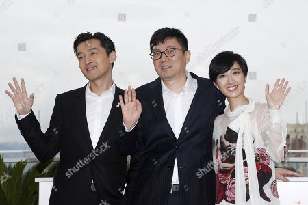 Hu Ge, Chinese director Diao Yinan and Taiwanese actress Gwei Lun Mei pose during the photocall for 'Nan Fang Che Zhan De Ju Hui' (The Wild Goose Lake) at the 72nd annual Cannes Film Festival, in Cannes, France, 19 May 2019. The movie is presented in the Official Competition of the festival which runs from 14 to 25 May.