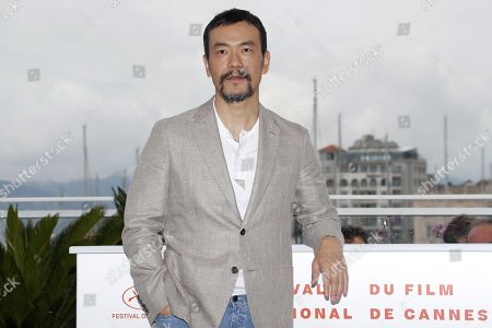 Liao Fan poses during the photocall for 'Nan Fang Che Zhan De Ju Hui' (The Wild Goose Lake) at the 72nd annual Cannes Film Festival, in Cannes, France, 19 May 2019. The movie is presented in the Official Competition of the festival which runs from 14 to 25 May.