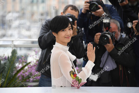 Kwai Lun-mei poses for photographers at the photo call for the film 'The Wild Goose Lake' at the 72nd international film festival, Cannes, southern France
