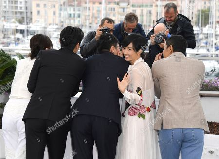 Kwai Lun-mei, second from right, poses for photographers at the photo call for the film 'The Wild Goose Lake' at the 72nd international film festival, Cannes, southern France