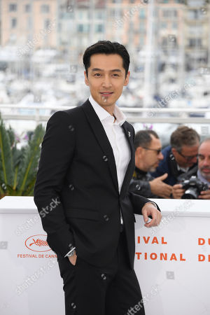 Hu Ge poses for photographers at the photo call for the film 'The Wild Goose Lake' at the 72nd international film festival, Cannes, southern France