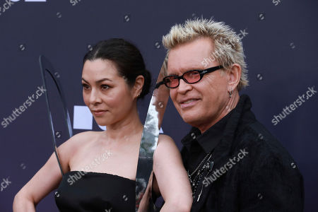 Stock Image of China Chow, Billy Idol. China Chow and Billy Idol attend the 2019 MOCA benefit at the Geffen Contemporary on in Los Angeles