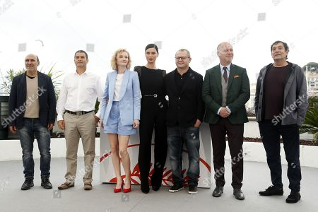 Spanish actor Antonio Buil, Romanian actor Francisco Corea, Romanian director Corneliu Porumboiu, Romanian actress Rodica Lazar, Romanian actress Catrinel Marlon, Romanian actor Vlad Ivanov and Spanish actor Agusti Villarongapose during the photocall for 'La Gomera' (The Whistlers) at the 72nd annual Cannes Film Festival, in Cannes, France, 19 May 2019. The movie is presented in the Official Competition of the festival which runs from 14 to 25 May.
