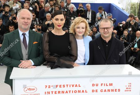 Vlad Ivanov, Catrinel Menghia, Rodica Lazar, Corneliu Porumboiu. Actors Vlad Ivanov, from left, Catrinel Menghia, Rodica Lazar and director Corneliu Porumboiu pose for photographers at the photo call for the film 'The Whistlers' at the 72nd international film festival, Cannes, southern France