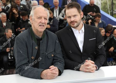 Stock Photo of Werner Herzog, Roc Morin. Director Werner Herzog, from left, and producer Roc Morin pose for photographers at the photo call for the film 'Family Romance' at the 72nd international film festival, Cannes, southern France