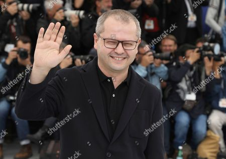 Corneliu Porumboiu poses for photographers at the photo call for the film 'The Whistlers' at the 72nd international film festival, Cannes, southern France