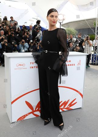 Catrinel Marlon poses for photographers at the photo call for the film 'The Whistlers' at the 72nd international film festival, Cannes, southern France