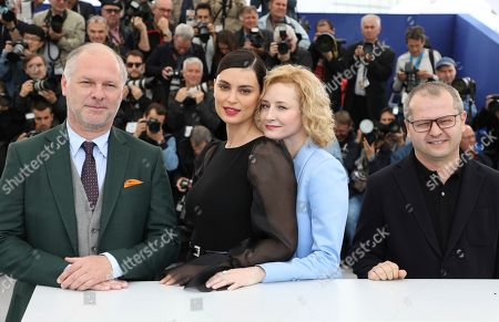 Vlad Ivanov, Catrinel Marlon, Rodica Lazar, Corneliu Porumboiu. Actors Vlad Ivanov, from left, Catrinel Marlon, Rodica Lazar and director Corneliu Porumboiu pose for photographers at the photo call for the film 'The Whistlers' at the 72nd international film festival, Cannes, southern France