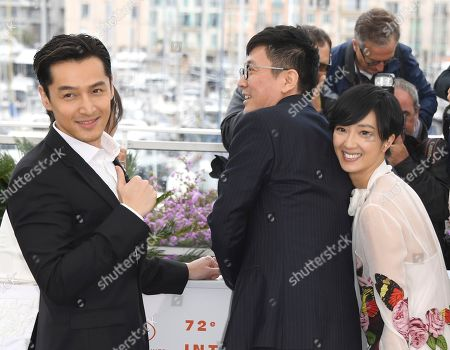 Stock Image of Hu Ge, Diao Yinan, Kwai Lun-mei. Actor Hu Ge, from left, director Diao Yinan and Kwai Lun-mei pose for photographers at the photo call for the film 'The Wild Goose Lake' at the 72nd international film festival, Cannes, southern France