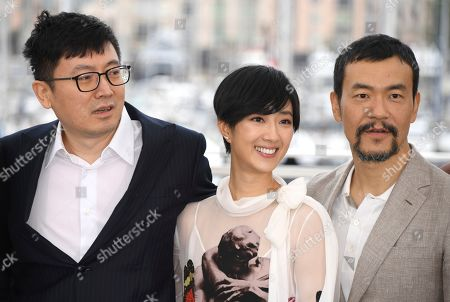 Diao Yinan, Kwai Lun-mei, Liao Fan. Director Diao Yinan, from left, actors Kwai Lun-mei and Liao Fan pose for photographers at the photo call for the film 'The Wild Goose Lake' at the 72nd international film festival, Cannes, southern France
