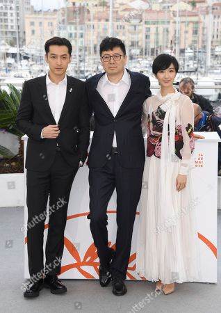 Hu Ge, Diao Yinan, Kwai Lun-mei. Actor Hu Ge, from left, director Diao Yinan and Kwai Lun-mei pose for photographers at the photo call for the film 'The Wild Goose Lake' at the 72nd international film festival, Cannes, southern France