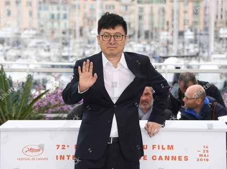 Diao Yinan poses for photographers at the photo call for the film 'The Wild Goose Lake' at the 72nd international film festival, Cannes, southern France
