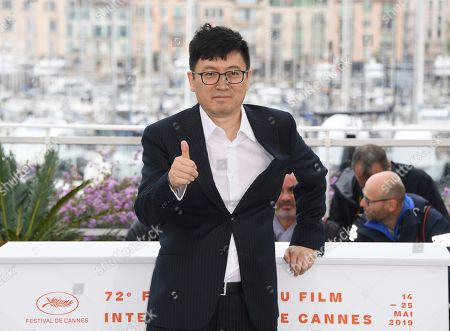 Stock Photo of Diao Yinan poses for photographers at the photo call for the film 'The Wild Goose Lake' at the 72nd international film festival, Cannes, southern France
