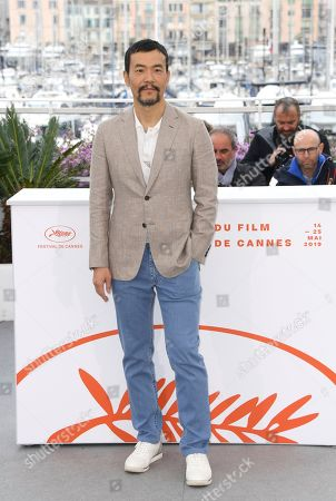 Liao Fan poses for photographers at the photo call for the film 'The Wild Goose Lake' at the 72nd international film festival, Cannes, southern France