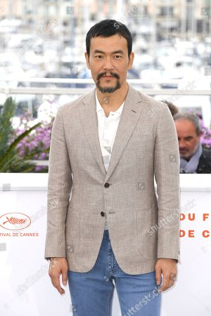 Stock Photo of Liao Fan poses for photographers at the photo call for the film 'The Wild Goose Lake' at the 72nd international film festival, Cannes, southern France